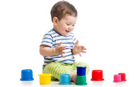 A baby playing cup stacking