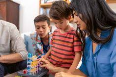 Kids play gravity maze puzzle with an educator